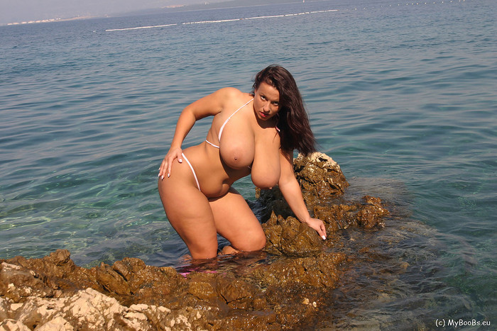 Aneta in mini Bikini on the beach - Aneta Buena