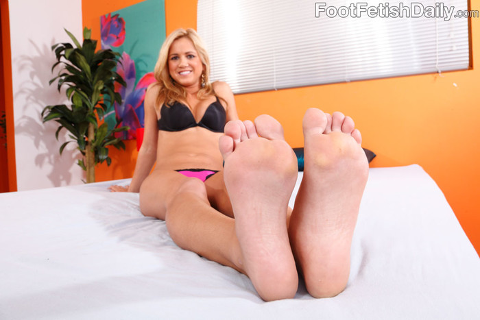 Ashley Abbott Wraps Her Sexy Black Toes Around a Hard Cock